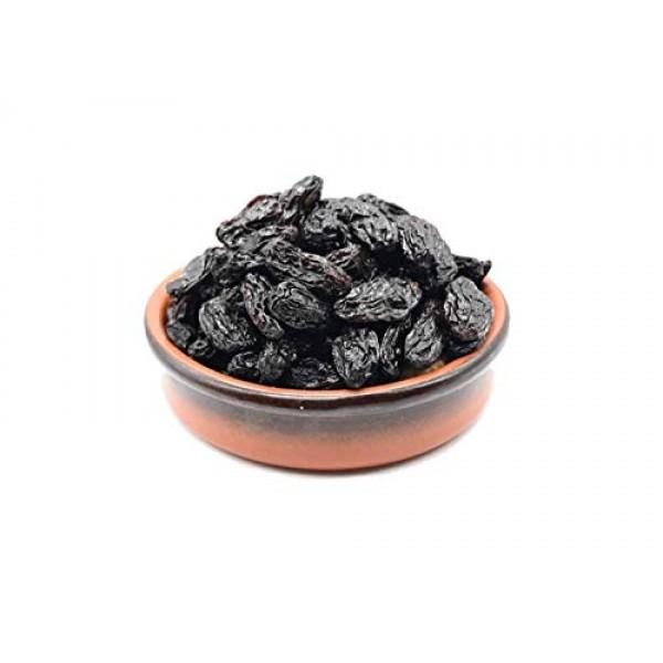 Black Dried Fresh Raisins Seedless, ready to eat resealable bag...