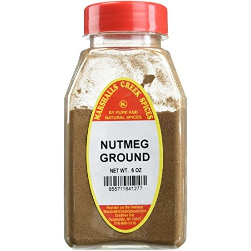 NUTMEG GROUND FRESHLY PACKED IN LARGE JARS, spices, herbs, seaso...