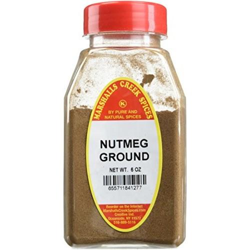 NUTMEG GROUND FRESHLY PACKED IN LARGE JARS, spices, herbs, seaso...