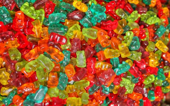 Hundreds of colorful gummy bears in bulk